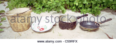 Camping equipment used by explorer Kypros in Africa - ideal minimum for cooking - bucket plates saucepan fryingpan - Stock Photo