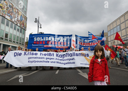 Demonstration in Berlin, anti capital crisis with small girl in front - Stock Photo