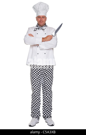 Photo of a chef in uniform with his arms folded holding a knife isolated on a white background. - Stock Photo