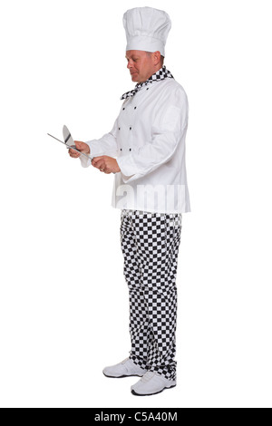Photo of a chef in white uniform sharpening a knife isolated on a white background. - Stock Photo