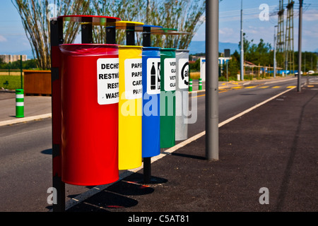 Colorful recycling containers at a tram station in Geneva, Switzerland - Stock Photo