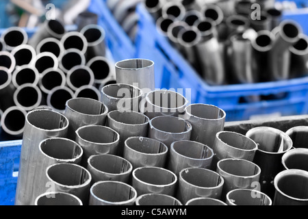 Gray Stainless Pipes Stacked In Storage Boxes They Are Used In Automotive Industry For The Exhaust System - Stock Photo