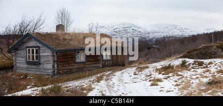 Cottage on snow covered landscape at Helagsfjället, Sweden - Stock Photo