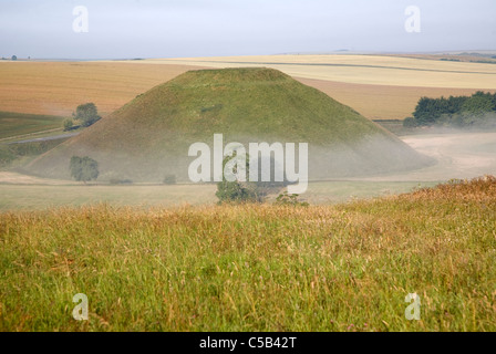 Silbury Hill is the largest man made prehistoric structure In Europe, near Avebury, Wiltshire, England - Stock Photo