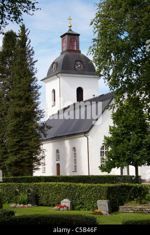 View of church with cemetery in the foreground at Dalarna, Sweden - Stock Photo