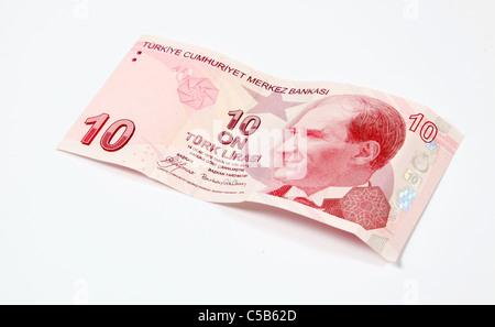 Ten Turkish Lira note -cut out on white - Stock Photo