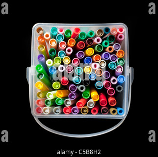 Plastic container full of colourful felt tip pens - Stock Photo