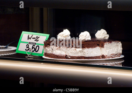 Delicious looking cake in a shop window in a town in Poland. - Stock Photo