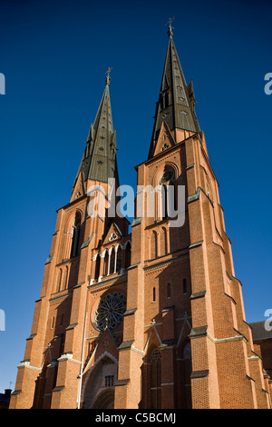 Low angle view of Uppsala cathedral against clear blue sky - Stock Photo