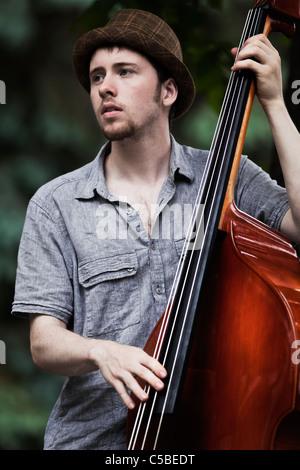Jazz musician playing Upright Bass - Stock Photo