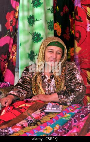 Fabric vendor, Urgut market, Samarkand, Uzbekistan - Stock Photo