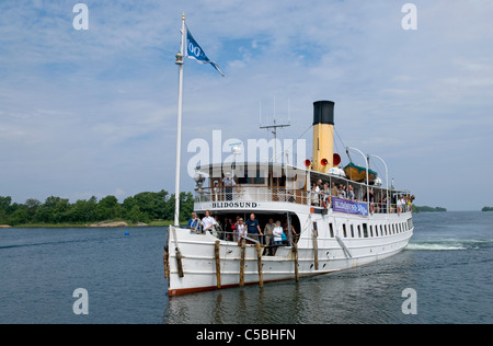 Stockholm archipelago's last coal-fired steamboat The S/S Blidösund celebrating its 100th birthday on the island - Stock Photo