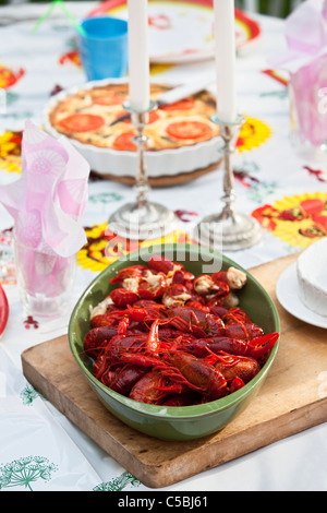 Close-up of a bowl of cray fish on dining table - Stock Photo
