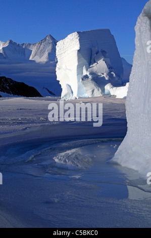 Mount Herschel with large ice berg from Cape Hallett northern Ross Sea Antarctica - Stock Photo
