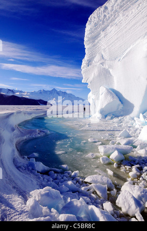 Mount Herschel with large ice berg from near Cape Hallett northern Ross Sea Antarctica - Stock Photo