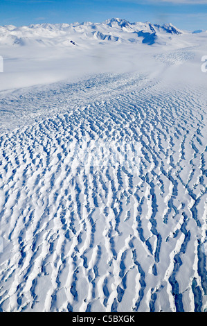 Large glacier flowing from Polar Plateau to Wood Bay Ross Sea Antarctica - Stock Photo