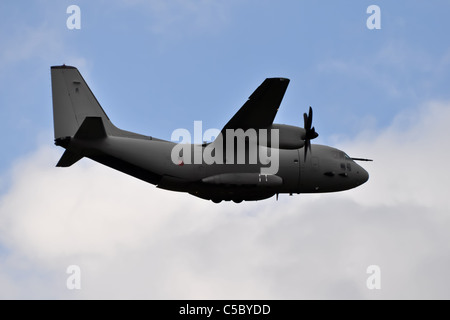military tactical air-transport and cargo plane in flight - Stock Photo