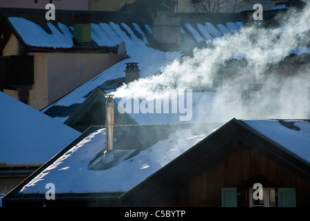 Close-up of smoke from chimney at Alpine chalet - Stock Photo