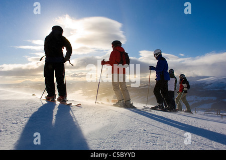 Group of skiers against cloudy sky - Stock Photo
