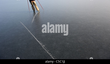 High angle view of traces of skater on frozen lake - Stock Photo