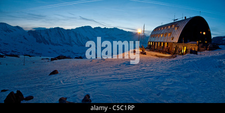 View of mountain hut in winter at dusk - Stock Photo
