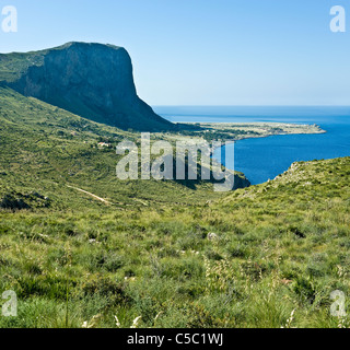 View green landscape of San Vito Lo Capo by the blue sea against clear blue sky - Stock Photo