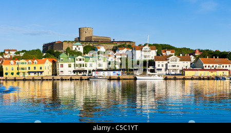 Houses in distance at Marstrand with reflection in water, Bohuslän, Sweden - Stock Photo