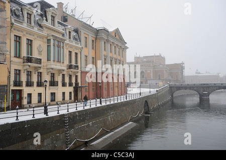 Buildings by canal in snow at Stockholm, Sweden - Stock Photo
