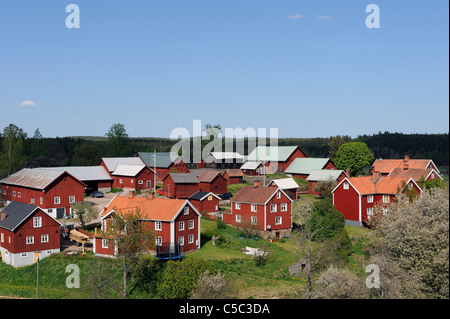 View of houses against clear blue sky at Visböle village - Stock Photo