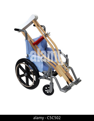 Crutches and wheelchair used for assistance in personal transportation when ambulatory methods are unavailable  - Stock Photo