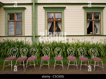 Chairs on display in front of the manor house - Stock Photo