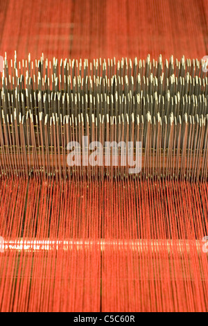 Detail shot of industrial red weaving linen - Stock Photo