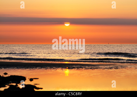 Sunset at ocean beach, Wangerooge, Germany. - Stock Photo
