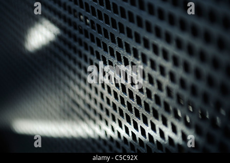 Old metal grid in perspective, short depth of field. - Stock Photo