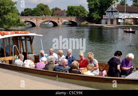 Elderly people sat in trip boat on River Avon, Stratford-upon-Avon, UK - Stock Photo