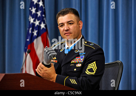 Medal of Honor recipient US Army Sgt. 1st. Class Leroy Petry touches his state-of-the-art prosthesis which replaced - Stock Photo