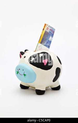 Piggy bank  with a Swiss Banknote of 10 Francs - Stock Photo