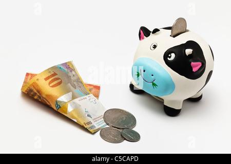 Piggy Bank with Swiss Money - Stock Photo