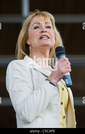 Sian Lloyd TV personality speaking at protest rally against proposed windfarms and infrastructure in the Welsh countryside - Stock Photo