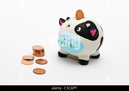 Piggy Bank with one penny coins - Stock Photo