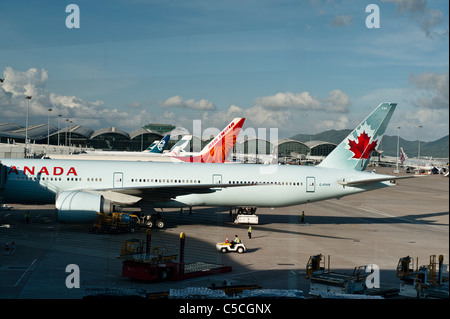Hong Kong International Airport. Afternoon at Chek lap Kok, Hong Kong International Airport. With Air Canada and - Stock Photo