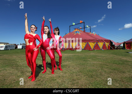 Female performers outside Zippos circus tent at a performance in the UK - Stock Photo