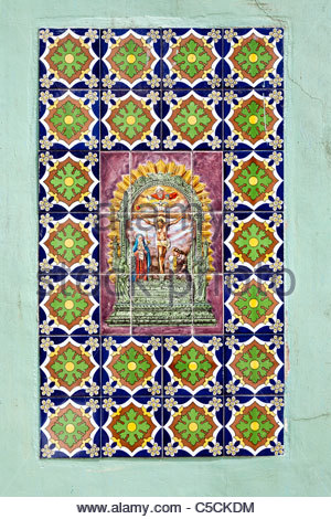 Hand-painted Azulejos Tiles depicting religious scenes in an abandoned building in Iquitos, Loreto, Peru - Stock Photo