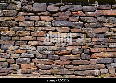 Old stone wall that makes a great background or texture - Stock Photo