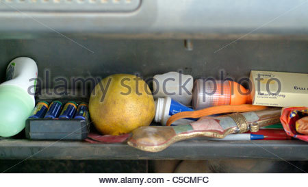 Camping equipment used by explorer Kypros in Africa - dashboard with batteries recharging and LED torch flashlight - Stock Photo