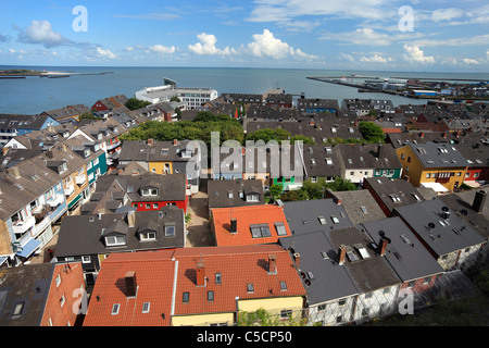 city with harbour on island Heligoland (Helgoland) and the island 'The Dune' ('Die Düne') in the background - Stock Photo