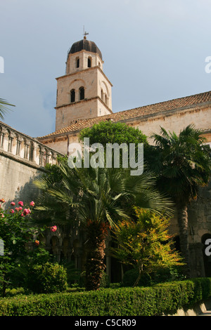 The cloister garden and the bell tower of the Franciscan Monastery (Franjevacki Samostan) in Dubrovnik, Croatia. - Stock Photo