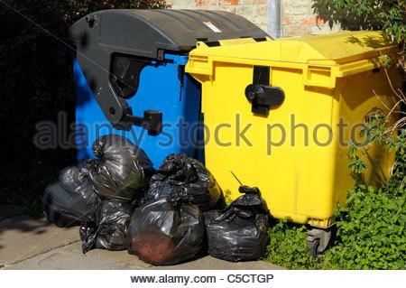 Bins and bin bags at Wimborne Minster in Dorset, England, UK - Stock Photo