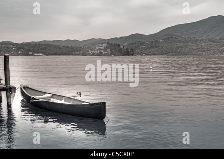 Photo retro look with a rowboat on Lake Orta and views of the island of San Giulio - Stock Photo