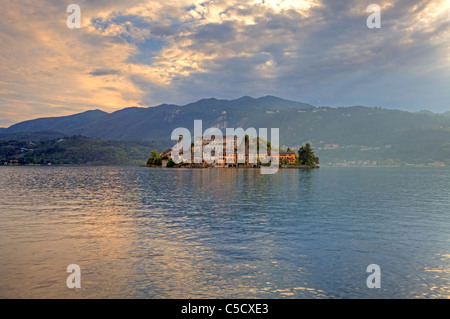 the island of San Giulio on Lake Orta in the evening sun - Stock Photo